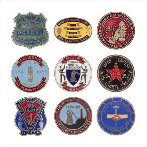 Greetings card of a collection of enamel badges from the Durham area.