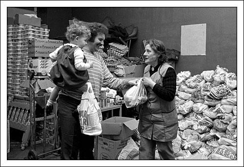Postcard of distributing food packages to striking miners and their families at Maerdy Miners' Institute in February 1985.