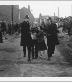 The greetings card of of Josie Smith, a retired and siabled miner, being escorted by police officers after being arrested outside his back gate. His wife is appealing for him to be released.