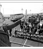 Postcard of demonstration by Labour Party Young Socialists and miners at the Conservative Party Conference in 1984.